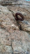 Rock Climbing Photo: An old ring-bolt pounded into a crack in the rock,...