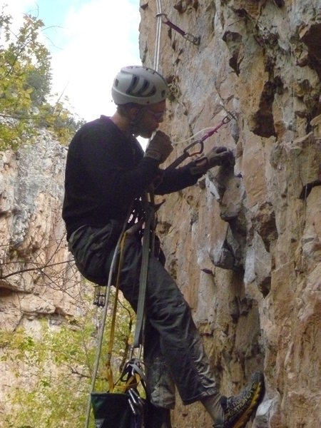 Rock Climbing Photo: One of the crew installing new bolts.