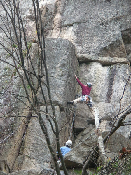 Rock Climbing Photo: Unknown climber spread-eagled on the crux dihedral...