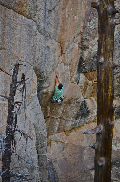 Tall climber beginning the short person crux.  Photo: John Hinrichsen.