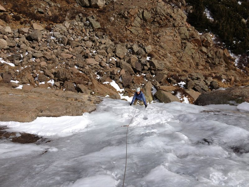 Nov. 3, 2012. Meagan Buck topping out the steep part of Columbine Falls. WI2 to the top. About 95ft to the top.