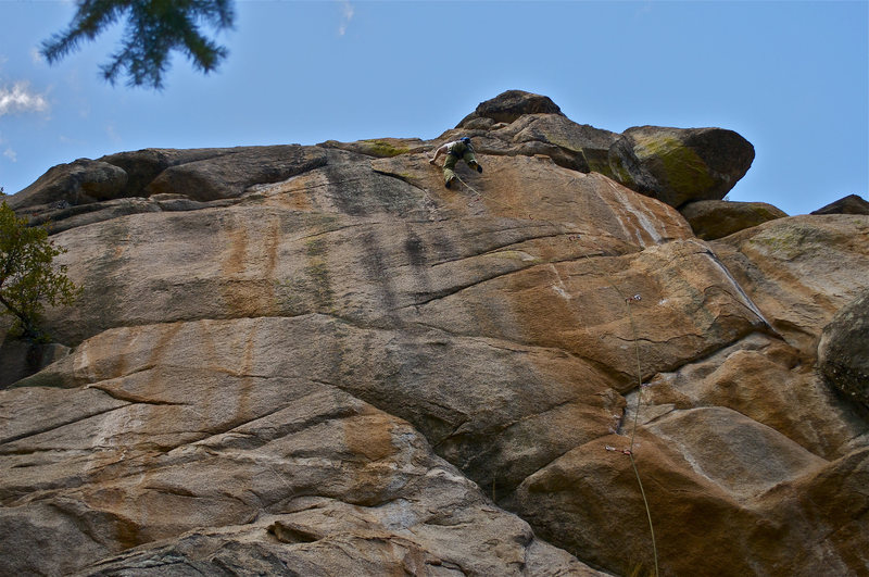 John Hinrichsen pulling through the second technical crux towards the Red Wood anchors.  Photo: Elisa Phillips.