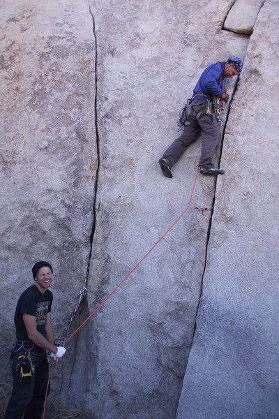 Oh, F**k, I forgot the rack.  Can you just toss it up to me?  Two highball cracks on the rear end of the headstone pile that cowards can rope up.... Photo and rack lobber, Dave Rockwell@SEMICOLON@ laughing belayer, Todd Bradley, climber, embarrassed.