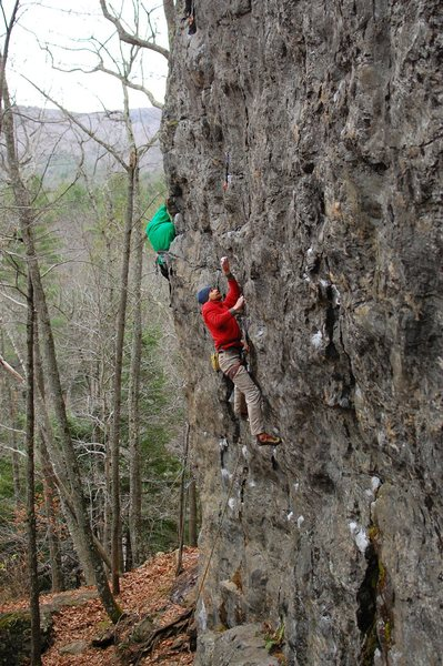 Sam making the reach to an OK crimp that starts the easier but pumpy climbing above.