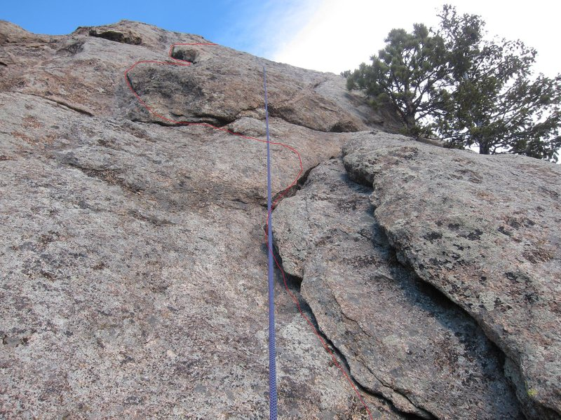Looking up from above the dihedral (while rope-soloing). Note the ledge with the 2 trees on the right.