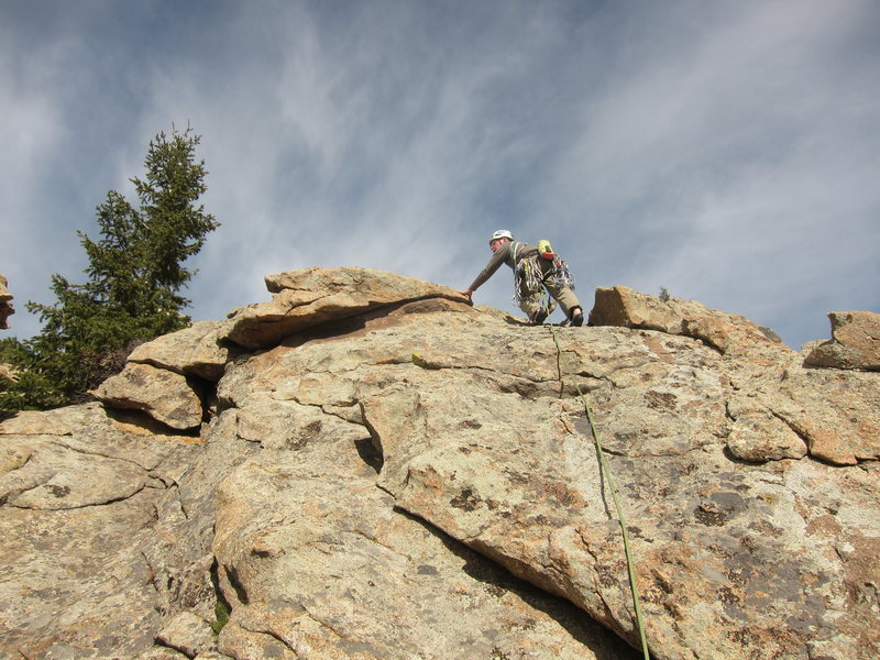 Rock Climbing Photo: Norm topping out.