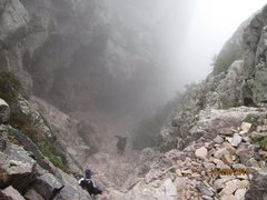 Rock Climbing Photo: Descending back into the storm