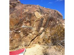 South Face of Warmup Boulder. <br /> <br />-Catharsis V6/7 (Pink) <br />-Rambo Redux V8 (White) <br />-Rambo Rail V3 (Red) <br />-Rambo Direct V4 (Yellow) <br />-Chuck V5 (Blue) <br />-Jimbo Deluxe V7 (Green)