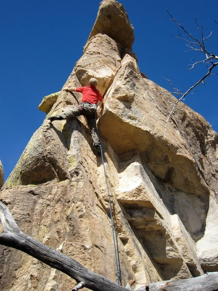 Just after getting around the roof and into the corner.  Bonnie climbs to the left of the arete.  Photo: Jimbo