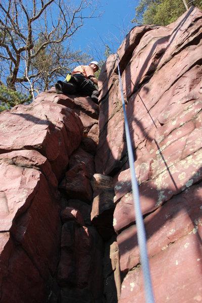 Climbing up the crack.