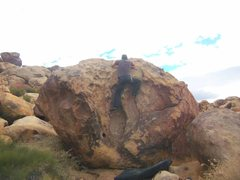 Rock Climbing Photo: Pinching the top knobs and bringing up feet.