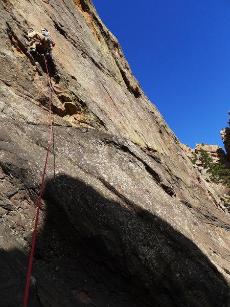 Rock Climbing Photo: Matt high stepping to start the real climbing.