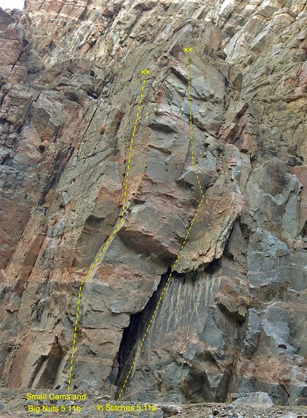 In Stitches 5.11a.  Begins in the wide chimney up into the dihedral and then out left onto the face.