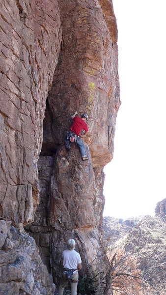 Geir getting into the sustained steepness, Jimbo belaying.