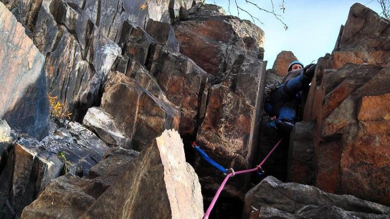 going through the chimney on the fourth pitch