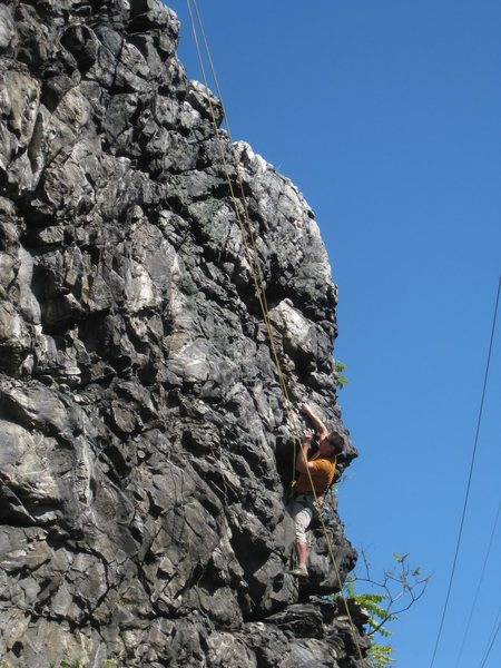 C.O. on the lower half of Mojo Filter. The rope is set up for the full route rather than Mojo Filter (right), which finishes straight up from the climbers current position. Mojo Filter trends upward and slightly left from the climbers current position, as evidenced by the line of the rope.