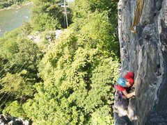 Rock Climbing Photo: Climber looking for gear at the top of Cold Steel ...