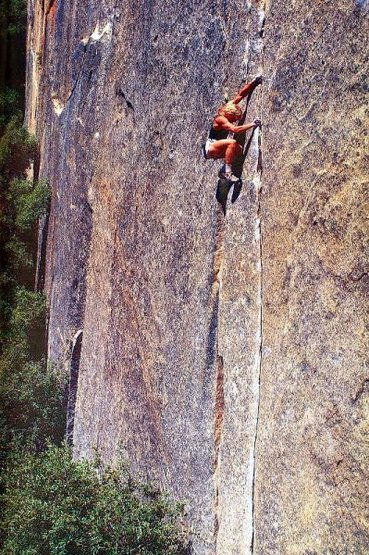 John Bachar soloing Crack-a-Go-Go (5.11c), Yosemite Valley <br> <br> Photo by Phil Bard