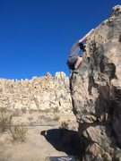 Rock Climbing Photo: Topin out on Hang Man problem