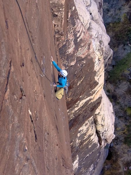 Allison climbing the superb rock and wild position on the third pitch. November 2012.