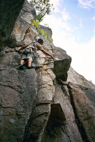 Luan Kruger of S Africa contempeting the 5.9 + crux on Diedra, Cathedral Ledges, NH