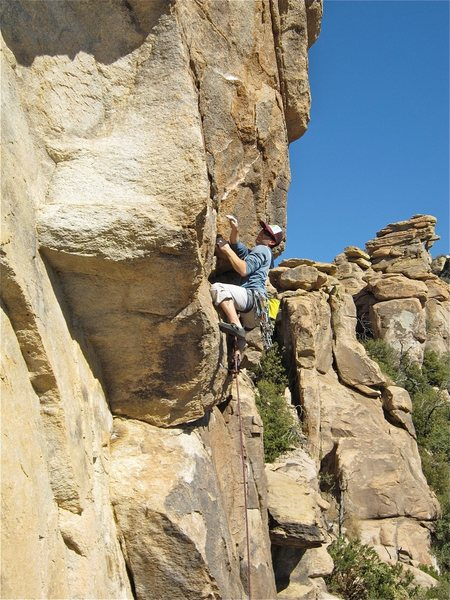 David Merin onsighting the route with a trad rack as training weight.