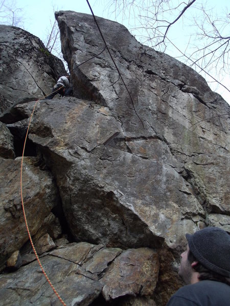 Jon getting to the first bolt and thats me on belay