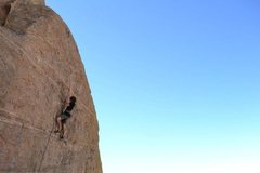 Rock Climbing Photo: Starting the crux finishing sequence.  Photo by Cl...