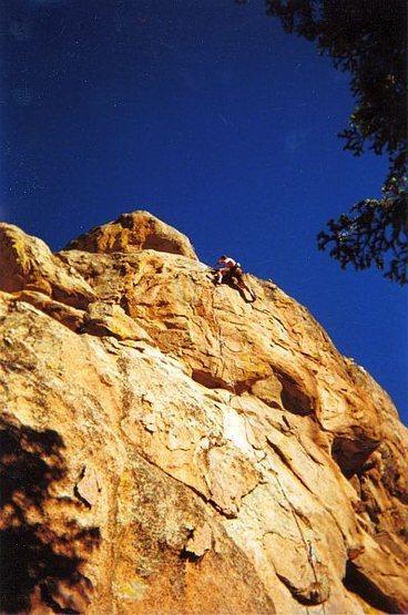 Golden light on Ricochet (5.10a), Holcomb Valley Pinnacles