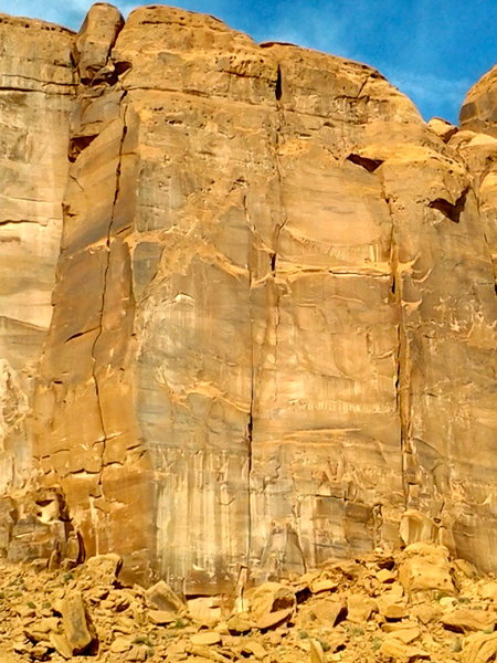 Not the best photo but it shows the route which is the crack system in the center. To the left is a three pitch climb following a wide crack system.