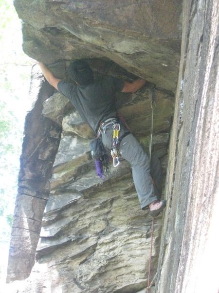 Rock Climbing Photo: Climber pulling through the roof on Rags To Riches