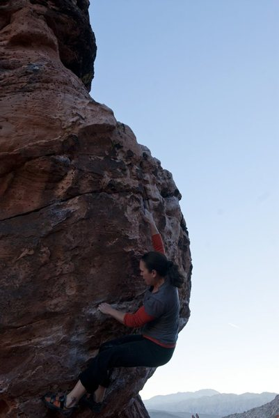 Reaching up to the last great hold on Monkey Left... Next move, get your feet up and go for the top! :)  Awesome Route!!