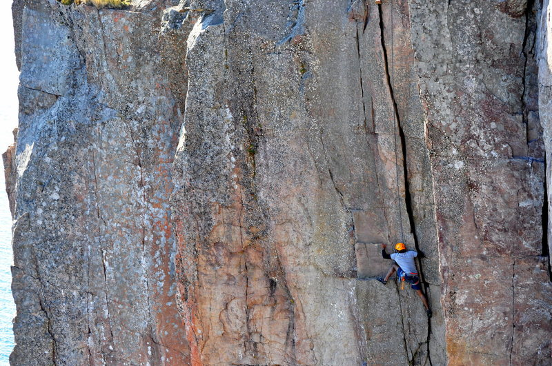Climbing a 5.9 route at Palisade Head, MN