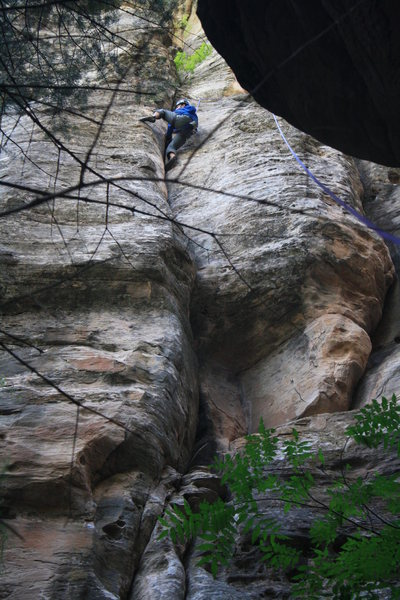 Rock Climbing Photo: Taylor holding on to the much harder finish of Uru...