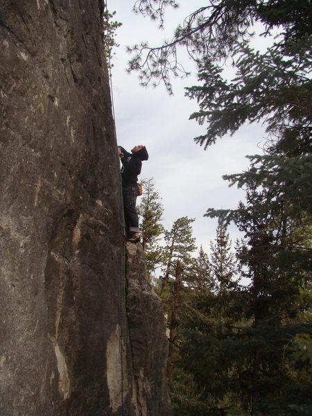 Climber sizes up the next moves on Bugs Bunny, 5.8.<br> <br> The Bunny Slope. Sunshine Wall.<br> Spearfish Canyon, SD.