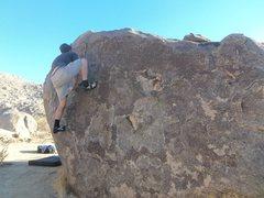 Rock Climbing Photo: Awkward high step mantle on crimps
