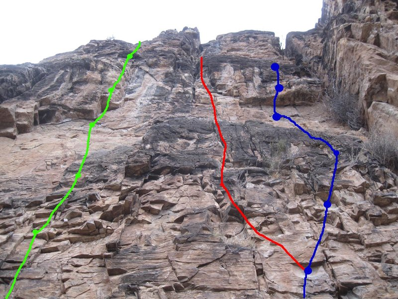 Three routes close together. Fresh Fried Chicken (5.10d) in blue; Giblet Gravy (5.10b) is green; Mashed Potatoes (5.9 trad, now retrobolted) is red.