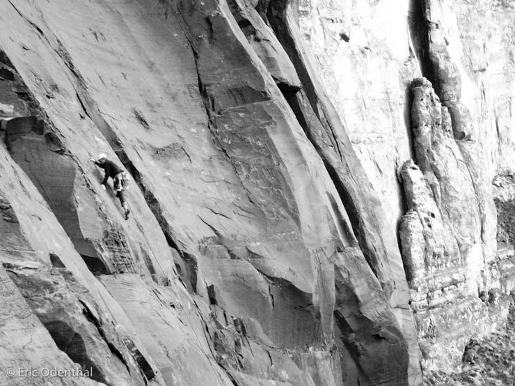 climber dude just reaching the crux on Night Light 5.10a.