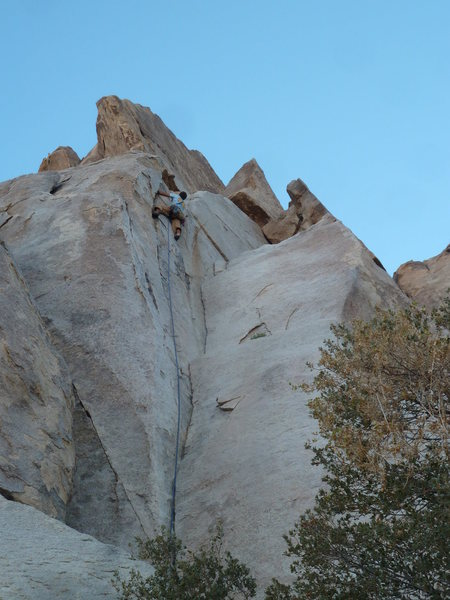 Mike Holley cruising the double cracks up high. (Anchors are up and left)