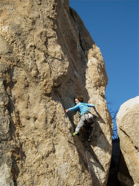Julie Messier starting the first crux.  Photo:J. Bruegger.