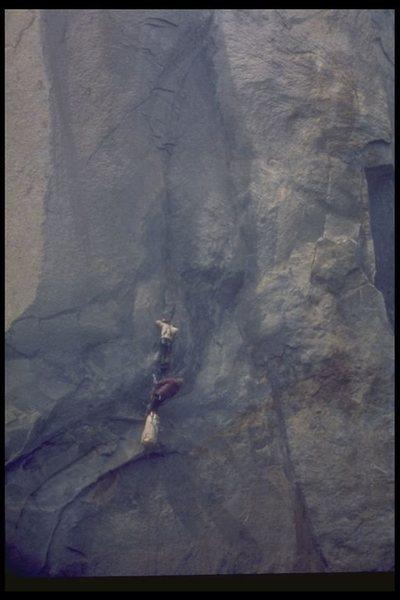 Al Bartlett & Steve Eddy, 3rd ascent of Tangarine Trip, taken through telescope from Valley floor.