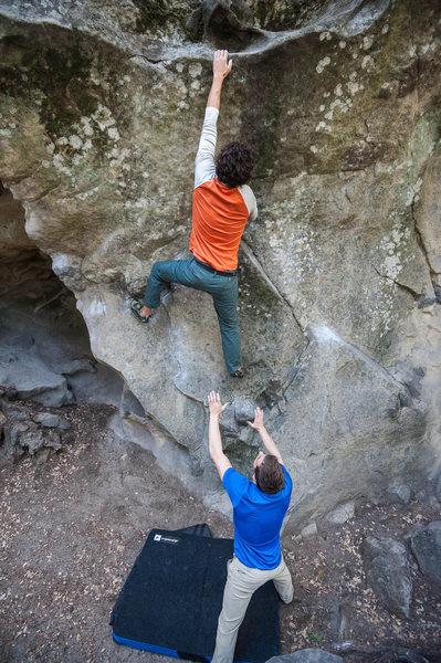 Long reach on the Waimea Wall.