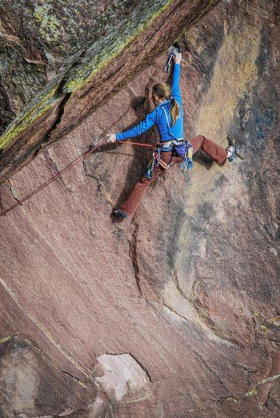 Rock Climbing Photo: Photo: Andy Mann. Lynn Hill plugs a piece of gear ...