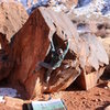 Christian Prellwitz climbing 'La Derecha Sit Start' (v4) at Big Bend- Moab, Utah.