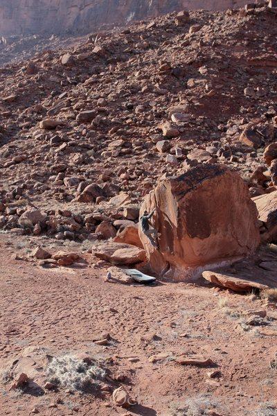 Christian Prellwitz climbing 'Split Decision' (v1+) at Big Bend in Moab, Utah.