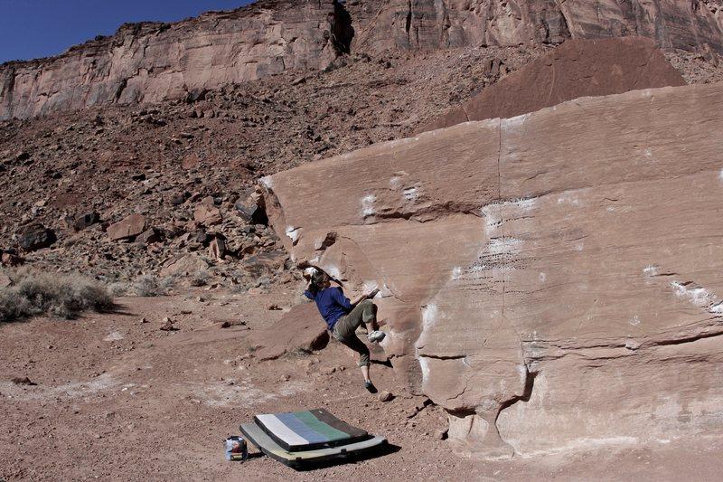 Lexi Tuddenham climbing 'The Pregnancy Arete' (v2+) at Big Bend in Moab, Utah.