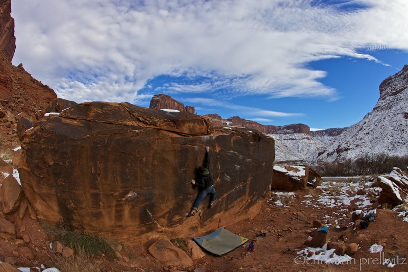 Christian Prellwitz climbing 'Slots Of Fun' (v2) at Big Bend in Moab, Utah.