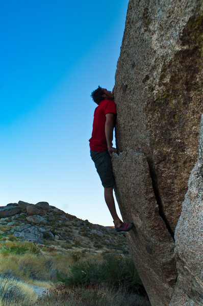 "Nick Ciotti mantels up his new route (v3+) ""Illustrator"" on the Vector Boulder. Start on Vector crack then mantel up the middle of the large flake to a knob and top out."