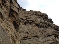 Looking up pitch 4. Bolt on the left is for the Solid Gold route. Take the right dihedral for Playin' Hooky.