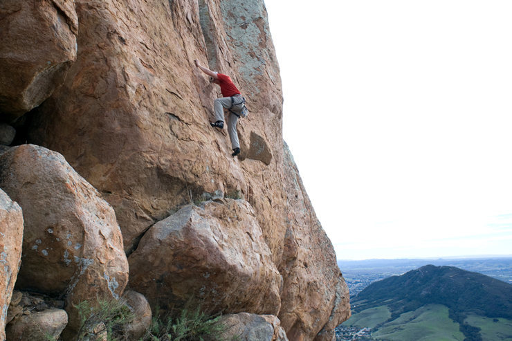 Matthew Fienup climbs Dig a Pony (5.10d) at Bishop's Peak.
